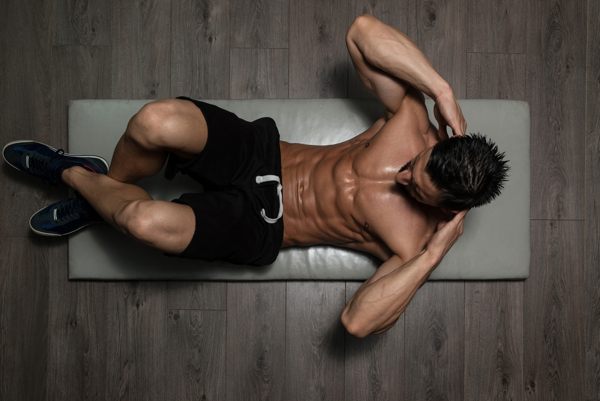 Healthy Man Exercising Abdominals On Foor